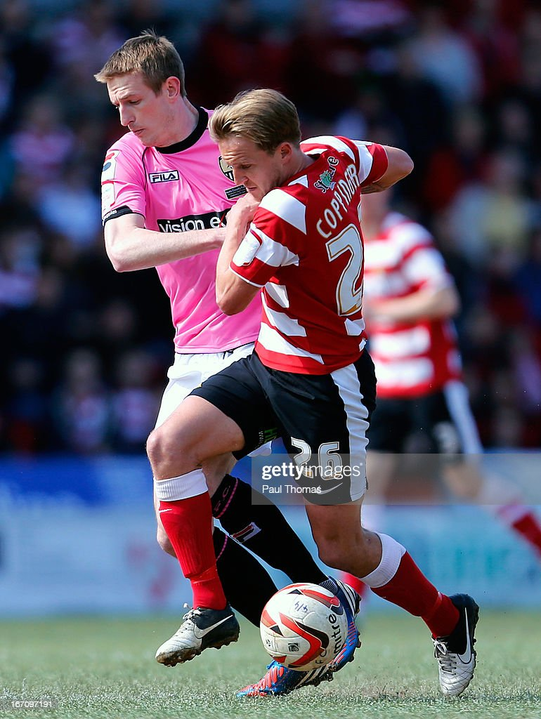 James Coppinger (R) of Doncaster in action with Jeff Hughes of Notts County during the npower League One match between Doncaster Rovers and Notts County at the Keepmoat Stadium on April 20, 2013 in Doncaster, England.