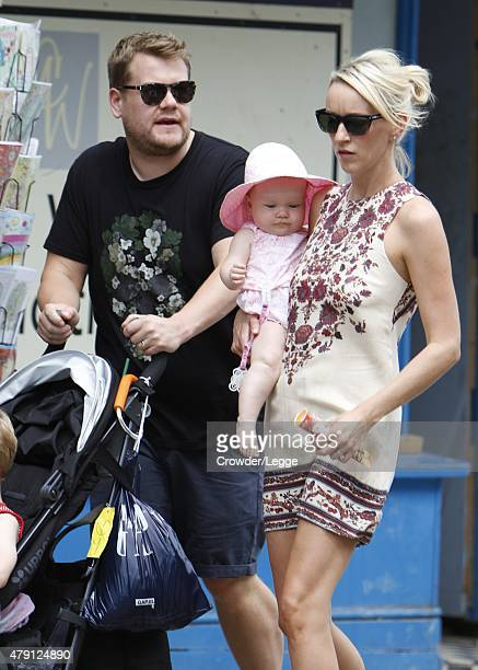 James Corden and Julia Carey are seen enjoying the sunshine as they walk through Primrose Hill with their children on July 1 2015 in London England