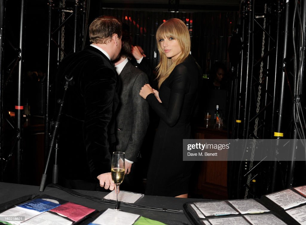 James Corden (L) and Taylor Swift attend the Universal Music Brits Party hosted by Bacardi at the Soho House pop-up on February 20, 2013 in London, England.