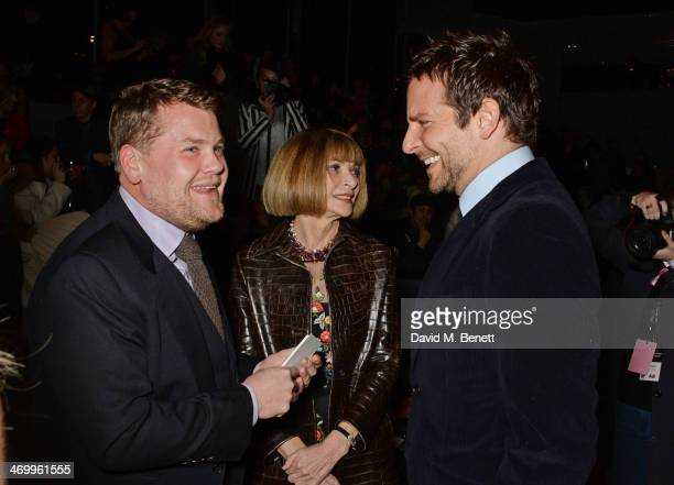 James Corden Anna Wintour and Bradley Cooper attend the TOM FORD show at London Fashion Week AW14 at The Lindley Hall on February 17 2014 in London...