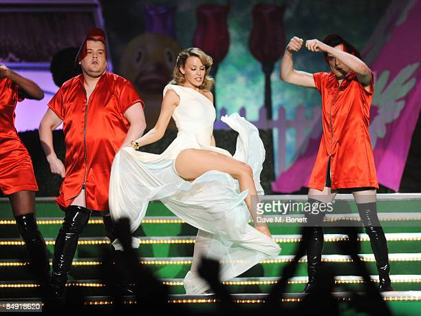 James Corden Kylie Minogue and Mathew Horne perform on stage during The Brit Awards 2009 at Earls Court One on February 18 2009 in London England