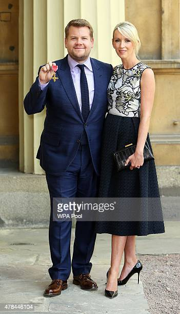 James Corden poses with wife Julia Carey after being awarded an OBE by the Princess Royal at an investiture ceremony at Buckingham Palace on June 25...