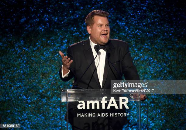 James Corden speaks on stage at amfAR Los Angeles 2017 at Ron Burkle's Green Acres Estate on October 13 2017 in Beverly Hills Californi