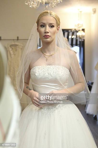 James Corden took newly engaged rapper Iggy Azalea to try on wedding dresses during their ride along together for 'Carpool Karaoke' airing Thursday...