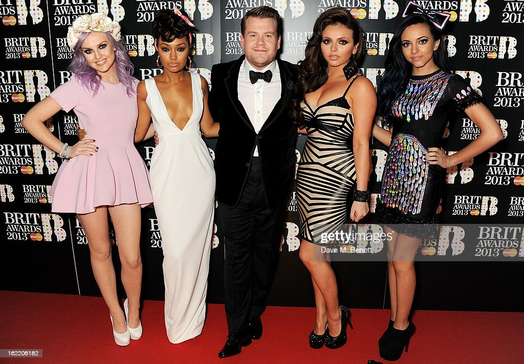 James Corden (C) with (L to R) Perrie Edwards, Leigh-Anne Pinnock, Jesy Nelson and Jade Thirlwall of Little Mix arrive at the BRIT Awards 2013 at the O2 Arena on February 20, 2013 in London, England.