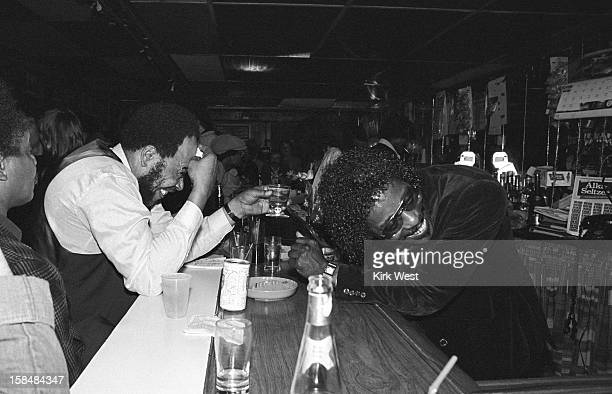 James Cotton and Buddy Guy raise a toast during Muddy Waters' wake at The Lounge Chicago Illinois May 3 1983