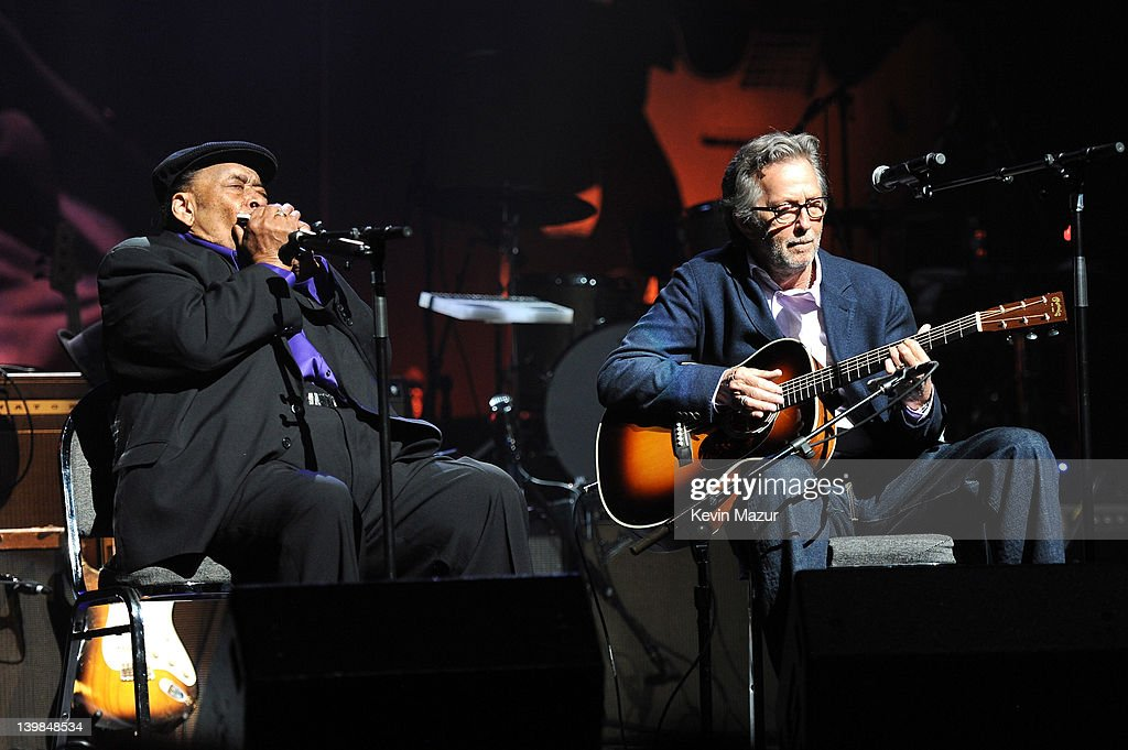 James Cotton and Eric Clapton perform on stage during Howlin For Hubert: A Concert to Benefit the Jazz Foundation of America at The Apollo Theater on February 24, 2012 in New York City.