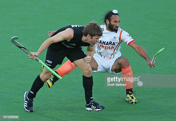 James Coughlan of New Zealand and Sardar Singh of India collide as they contest for the ball during the match between New Zealand and India during...