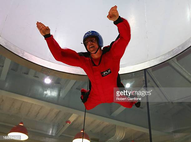 James Courtney driver of the Holden Racing Team Holden attempts indoor sky diving during previews ahead of the Austin 400 which is round five of the...