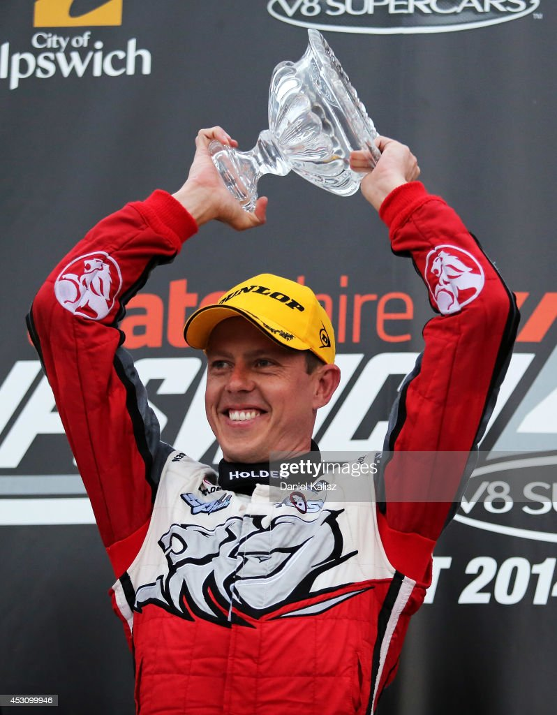 <a gi-track='captionPersonalityLinkClicked' href=/galleries/search?phrase=James+Courtney&family=editorial&specificpeople=675267 ng-click='$event.stopPropagation()'>James Courtney</a> driver of the #22 Holden Racing Team Holden celebrates on the podium after winning race 25 for the Ipswich 400, which is round eight of the V8 Supercar Championship Series at Queensland Raceway on August 3, 2014 in Ipswich, Australia.