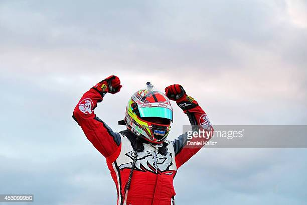 James Courtney driver of the Holden Racing Team Holden celebrates after winning race 25 for the Ipswich 400 which is round eight of the V8 Supercar...