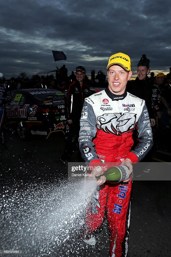 <a gi-track='captionPersonalityLinkClicked' href=/galleries/search?phrase=James+Courtney&family=editorial&specificpeople=675267 ng-click='$event.stopPropagation()'>James Courtney</a> driver of the #22 Holden Racing Team Holden celebrates after winning race 25 for the Ipswich 400, which is round eight of the V8 Supercar Championship Series at Queensland Raceway on August 3, 2014 in Ipswich, Australia.
