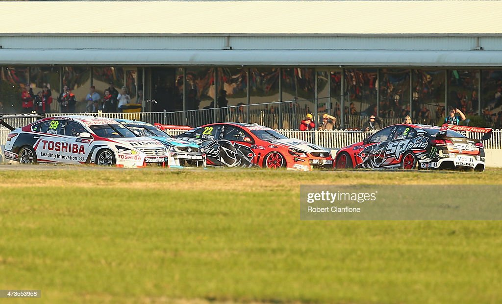 James Courtney driver of the Holden Racing Team Holden collides with team mate Garth Tander driver of the Holden Racing Team Holden at the start of...