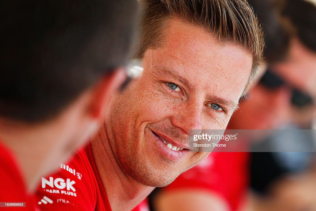 <a gi-track='captionPersonalityLinkClicked' href=/galleries/search?phrase=James+Courtney&family=editorial&specificpeople=675267 ng-click='$event.stopPropagation()'>James Courtney</a> driver of the #22 Holden Racing Team Holden looks on at an autograph session during previews ahead of the Bathurst 1000, which is round 11 of the V8 Supercars Championship Series on October 9, 2013 in Bathurst, Australia.