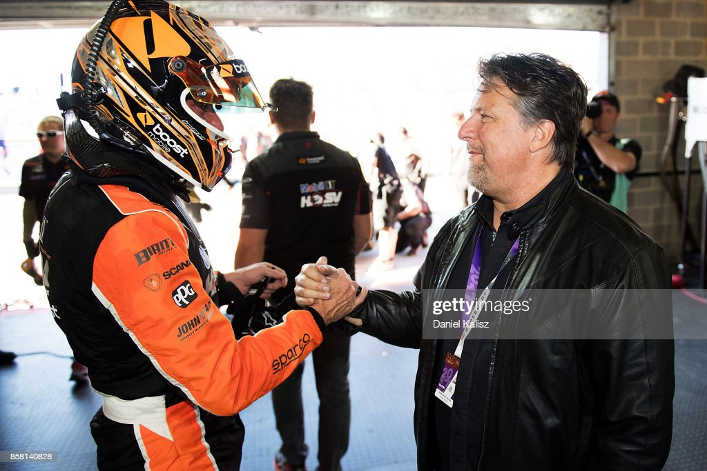 James Courtney driver of the #22 Mobil 1 HSV Racing Holden Commodore VF is congratulated by Michael Andretti of Andretti Motorsport during qualifying ahead of this weekend's Bathurst 1000, which is part of the Supercars Championship at Mount Panorama on October 6, 2017 in Bathurst, Australia.