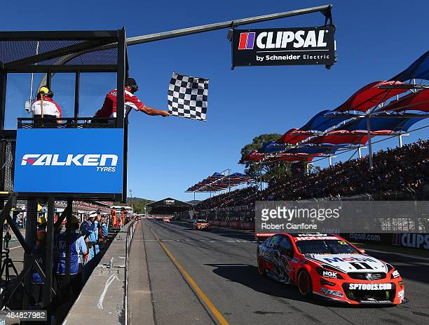 James Courtney drives the Holden Racing Team Holden across the finish line to win race three for the V8 Supercars Clipsal 500 at Adelaide Street...