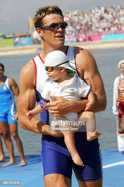 James Cracknell of Great Britain holding his baby son Croyde before receiving his Gold medal for the men's four rowing event on August 21 2004 during...