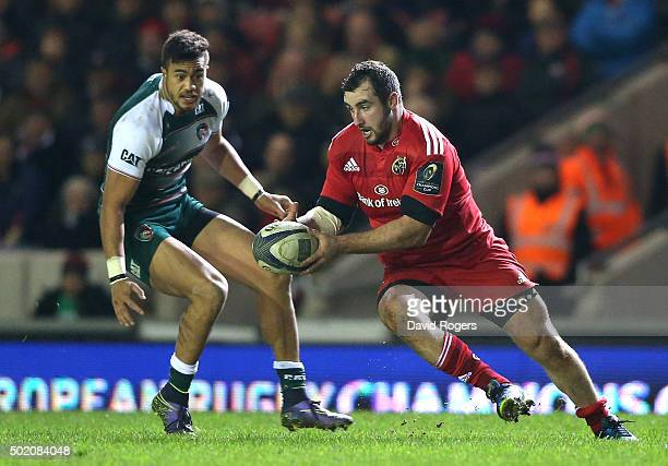 James Cronin of Munster moves past Peter Betham during the European Rugby Champions Cup match between Leicester Tigers and Munster at Welford Road on...