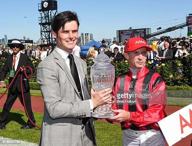 James Cummings and Glyn Schofield with the trophy after Prized Icon wins AAMI Victoria Derby at Flemington Racecourse on October 29 2016 in...