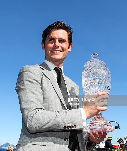 James Cummings receives the trophy after Prized Icon wins AAMI Victoria Derby at Flemington Racecourse on October 29 2016 in Flemington Australia