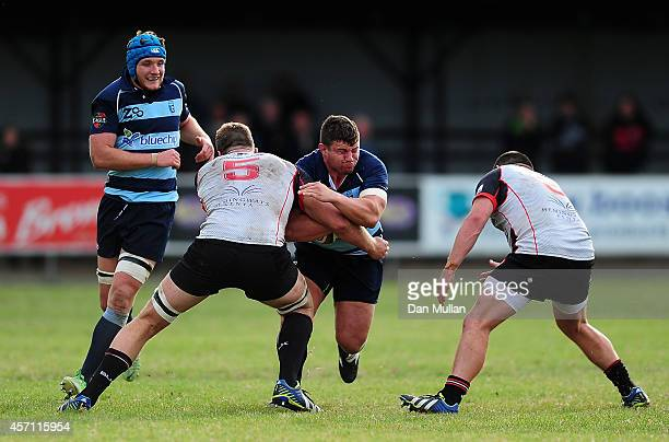 James Currie of Bedford Blues is tackled by Will CarrickSmith of Cornish Pirates during the British Irish Cup match between Cornish Pirates and...