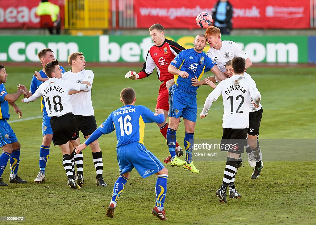 James Curtis of Gateshead heads clearduring the FA Cup Second Round tie between Gateshead FC v and Warrington Town at the Gateshead International Stadium on December 7, 2014 in Gateshead, England.