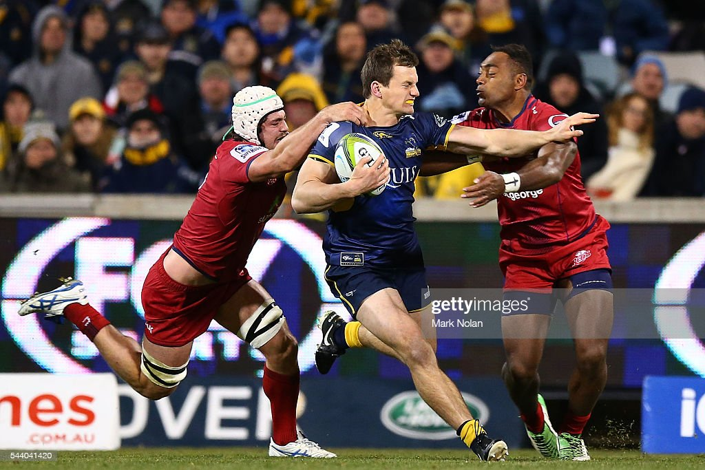 James Dargaville of the Brumbies is tackled during the round 15 Super Rugby match between the Brumbies and the Reds at GIO Stadium on July 1, 2016 in Canberra, Australia.