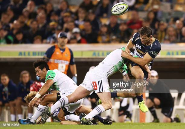 James Dargaville of the Brumbies is tackled during the round five Super Rugby match between the Brumbies and the Highlanders at GIO Stadium on March...