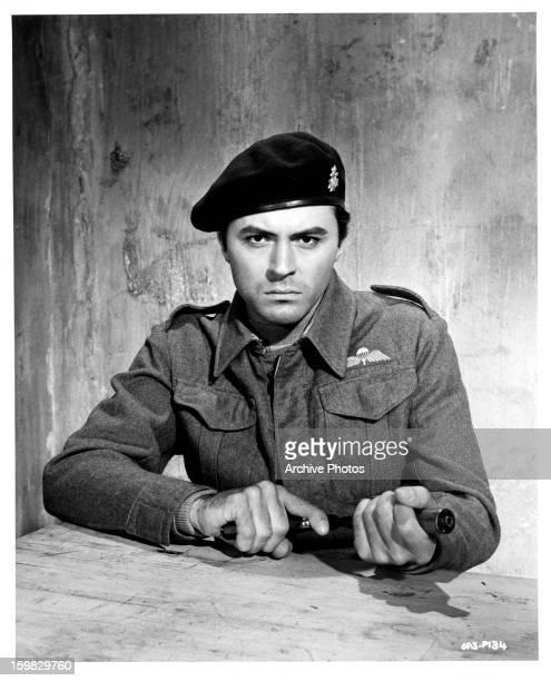 James Darren holding pistol in publicity portrait for the film 'The Guns Of Navarone' 1961