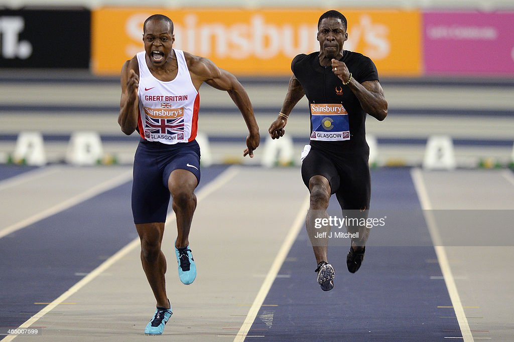 <a gi-track='captionPersonalityLinkClicked' href=/galleries/search?phrase=James+Dasaolu&family=editorial&specificpeople=7118567 ng-click='$event.stopPropagation()'>James Dasaolu</a> of Great Britain and <a gi-track='captionPersonalityLinkClicked' href=/galleries/search?phrase=Dwain+Chambers&family=editorial&specificpeople=215102 ng-click='$event.stopPropagation()'>Dwain Chambers</a> of the Commonwealth compete in the Men's 60 metres sprint during the British Athletics International Match at the Emirates Arena on January 25, 2014 in Glasgow, Scotland.