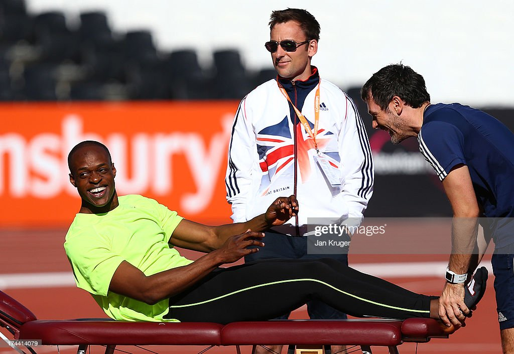 <a gi-track='captionPersonalityLinkClicked' href=/galleries/search?phrase=James+Dasaolu&family=editorial&specificpeople=7118567 ng-click='$event.stopPropagation()'>James Dasaolu</a> of Great Britain receives a massage during his warm up ahead of the Sainsbury's Anniversary Games - IAAF Diamond League at The Olympic Stadium on July 25, 2013 in London, England.