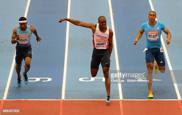 James Dasaolu of Great Britain wins the Men's 60m Final as he picks up an injury before the finish line with Michael Rodgers and Jimmy Vicaut during...