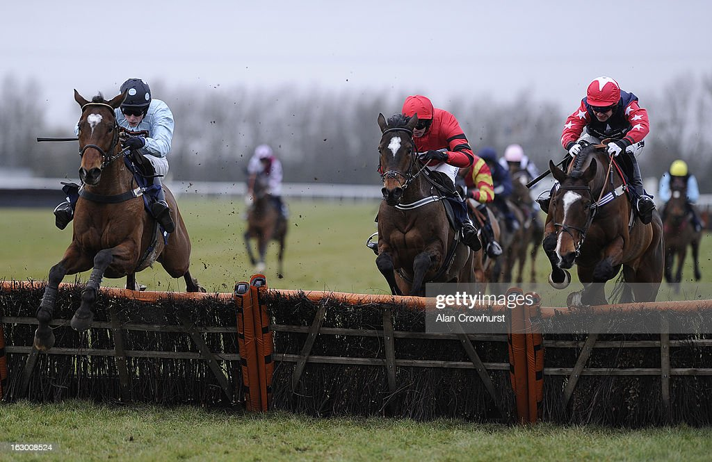 James Davies riding Ladies Dancing (L) clear the last to win The 32Red Casino Handicap Hurdle Race at Huntingdon racecourse on March 03, 2013 in Huntingdon, England.