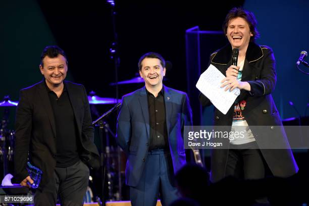 James Dean Bradfield Sean Moore and Nicky Wire of the Manic Street Preachers speak on stage at the 26th annual Music Industry Trust Awards held at...