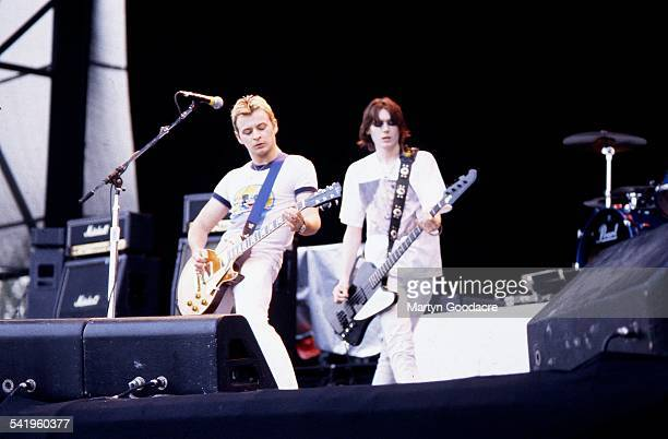 James Dean Bradfiield and Nicky Wire of Manic Street Preachers perform on stage at Milton Keynes Bowl United Kingdom 1993
