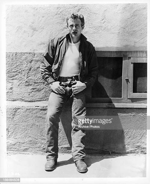 James Dean stands on a wall in a scene from the film 'Rebel Without A Cause' 1955