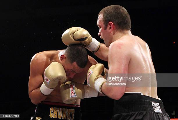 James DeGale and Alpay Kobal exchange punches during the SuperMiddleweightweight fight at the Braehead Arena on March 12 2011 in Glasgow Scotland