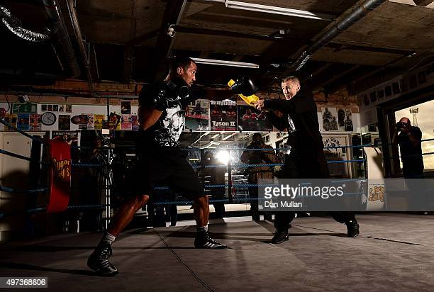 James DeGale of England boxes with Trainer Jim McDonnell during a workout ahead of his IBF World Super Middleweight title defence against Lucian Bute...