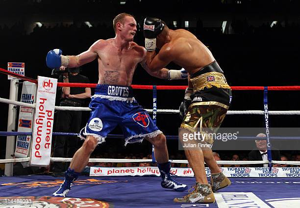 James DeGale of England receives a big right hand from George Groves of England in the British and Commonwealth SuperMiddleweight Championship during...
