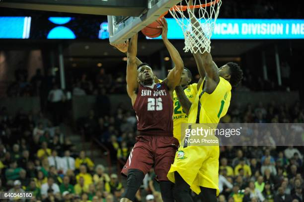 James Demery of Saint Joseph's University goes up for a layup over Jordan Bell and Chris Boucher of the University of Oregon during the 2016 NCAA...