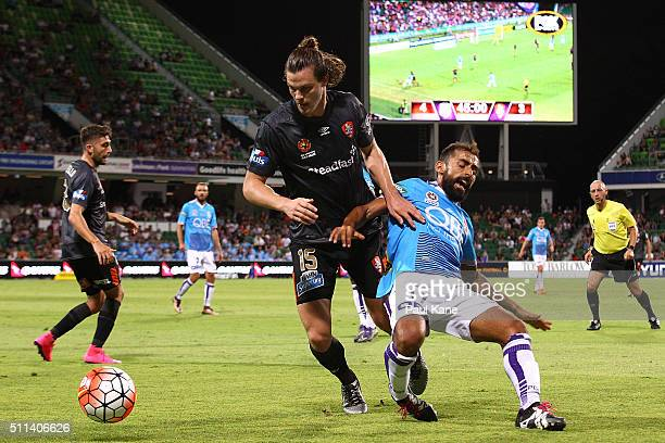 James Donachie of the Roar and Diego Castro of the Glory contest for the ball during the round 20 ALeague match between the Perth Glory and Brisbane...