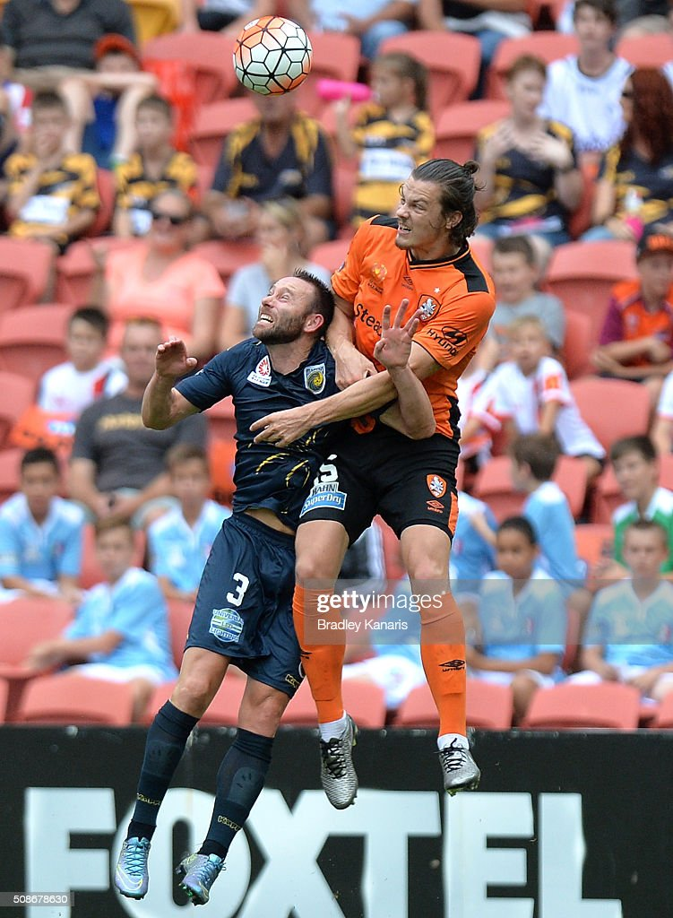 James Donachie of the Roar and Joshua Rose of the Mariners compete for the ball during the round 18 A-League match between the Brisbane Roar and Central Coast Mariners at Suncorp Stadium on February 6, 2016 in Brisbane, Australia.