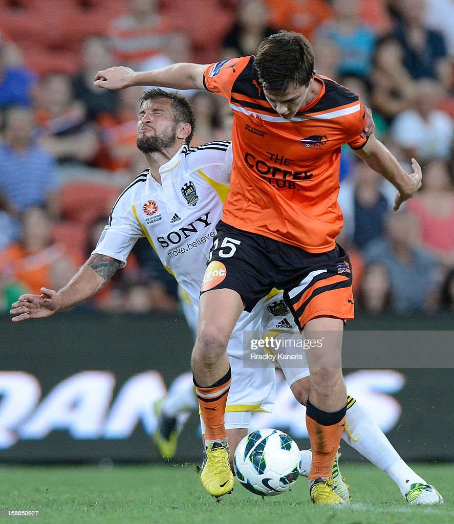 James Donachie of the Roar breaks free from the defence during the round 14 A-League match between the Brisbane Roar and the Wellington Phoenix at Suncorp Stadium on January 1, 2013 in Brisbane, Australia.