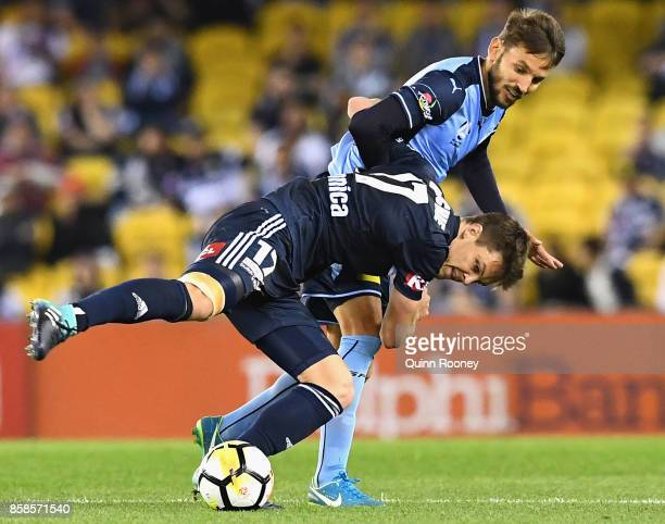 James Donachie of the Victory and Milos Ninkovic of Sydney FC compete for the ball during the round one ALeague match between the Melbourne Victory...
