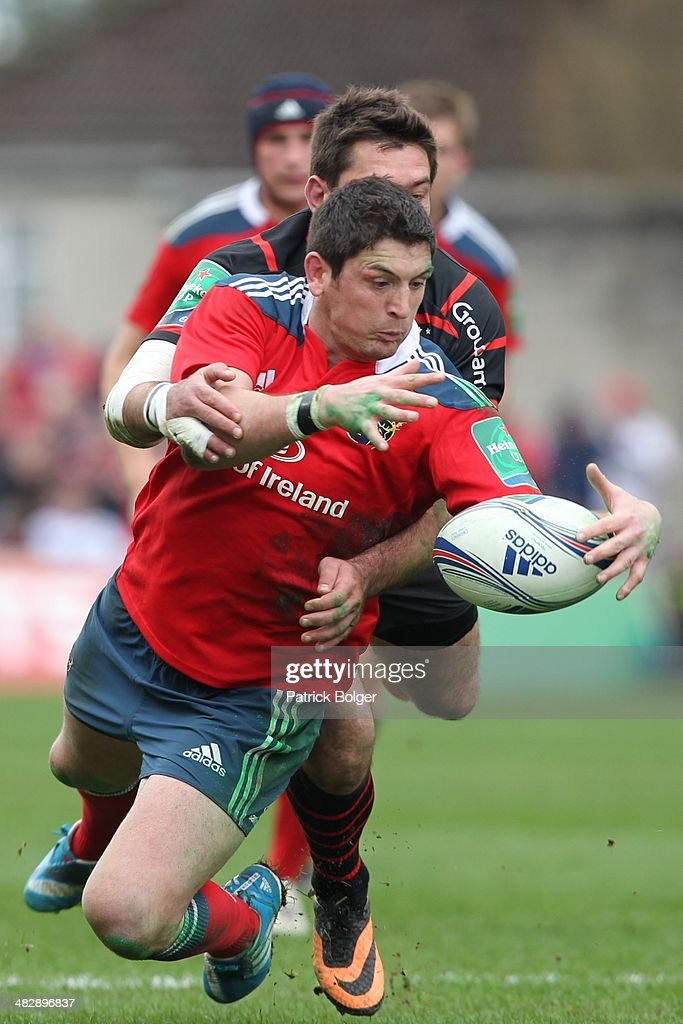 James Downey of Munster and <a gi-track='captionPersonalityLinkClicked' href=/galleries/search?phrase=Florian+Fritz&family=editorial&specificpeople=540919 ng-click='$event.stopPropagation()'>Florian Fritz</a> of Toulouse during the Heineken Cup Quarter Final match between Munster and Toulouse at Thomond Park on April 5, 2014 in Limerick, Ireland.