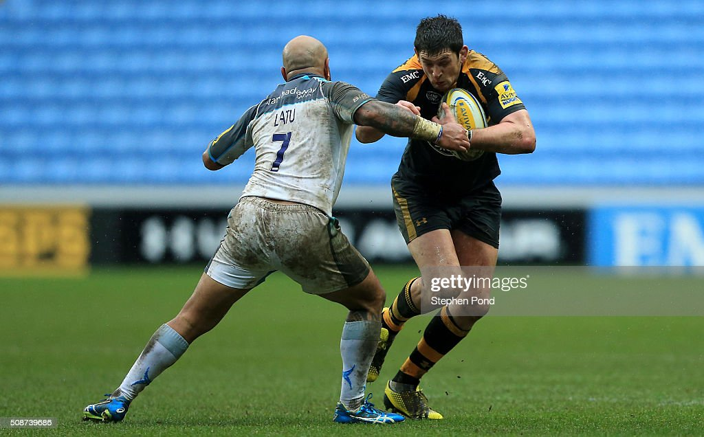 James Downey of Wasps is tackled by Nili Latu of Newcastle Falcons during the Aviva Premiership match between Wasps and Newcastle Falcons at the Ricoh Arena on February 6, 2016 in Coventry, England.