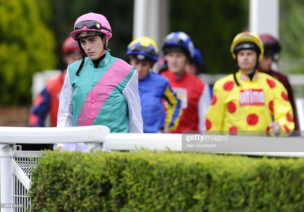 James Doyle leads the jockeys from the weighing room at Kempton Park racecourse on July 02, 2014 in Sunbury, England.