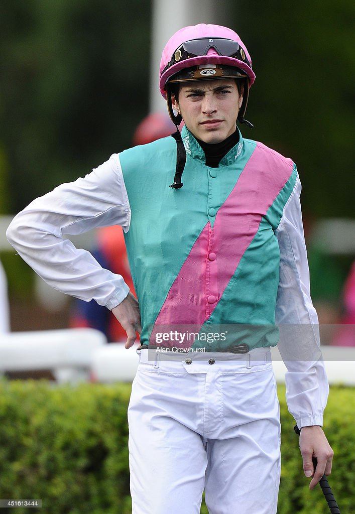 James Doyle poses at Kempton Park racecourse on July 02, 2014 in Sunbury, England.