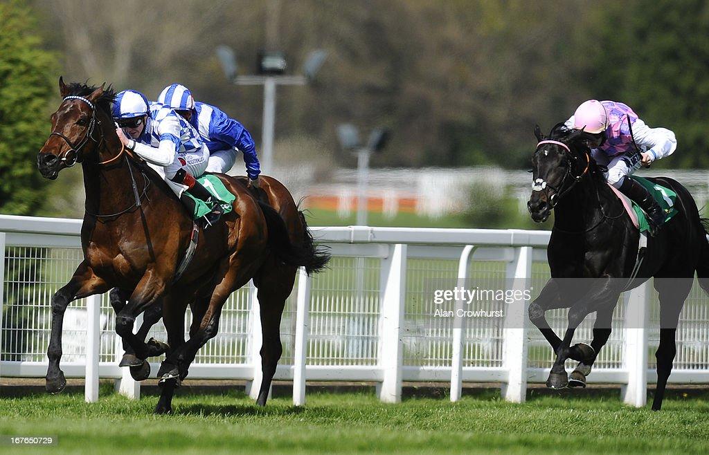 James Doyle riding Al Kazeem (L) win The bet365 Gordon Richards Stakes at Sandown racecourse on April 27, 2013 in Esher, England.