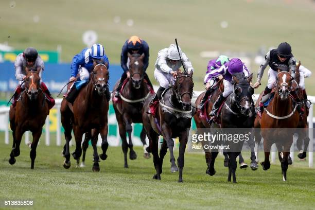 James Doyle riding Cardsharp win The Arqana July Stakes at Newmarket racecourse on July 13 2017 in Newmarket England
